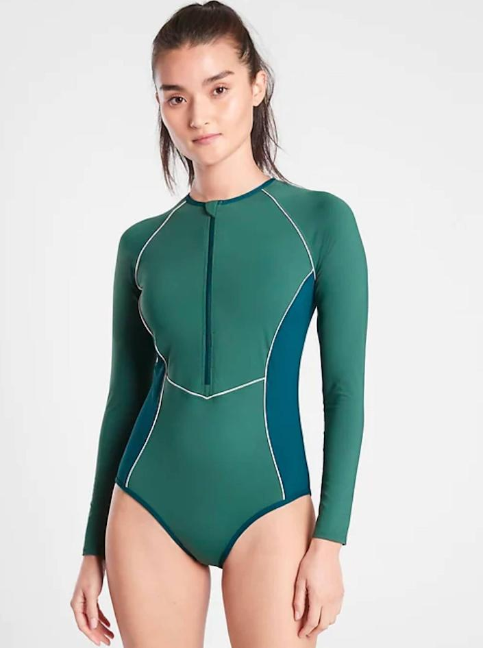 """The seams on this color-blocked rash guard give it a particularly flattering fit. Plus, it protects from the sun and has a shelf bra for support. $128, Athleta. <a href=""""https://athleta.gap.com/browse/product.do?pid=566760002&vid=1&tid=atpl000037&kwid=1&ap=7&gclid="""" rel=""""nofollow noopener"""" target=""""_blank"""" data-ylk=""""slk:Get it now!"""" class=""""link rapid-noclick-resp"""">Get it now!</a>"""
