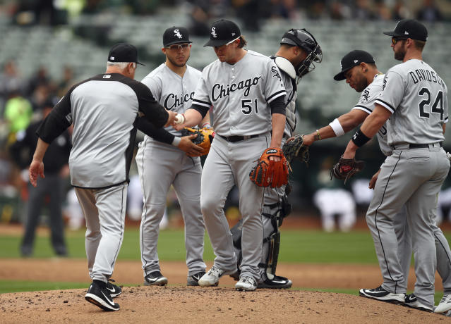 Chicago White Sox pitcher Carson Fulmer (51) hands the ball to manager Rick Renteria, left, as he is relieved during the second inning of a baseball game against the Oakland Athletics Wednesday, April 18, 2018, in Oakland, Calif. (AP Photo/Ben Margot)