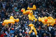 Pro-democracy demonstrators move inflatable rubber ducks during a rally in Bangkok