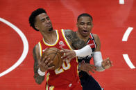 Atlanta Hawks forward John Collins (20) is fouled by Washington Wizards guard Russell Westbrook (4) during the first half of an NBA basketball game Wednesday, May 12, 2021, in Atlanta. (AP Photo/Butch Dill)