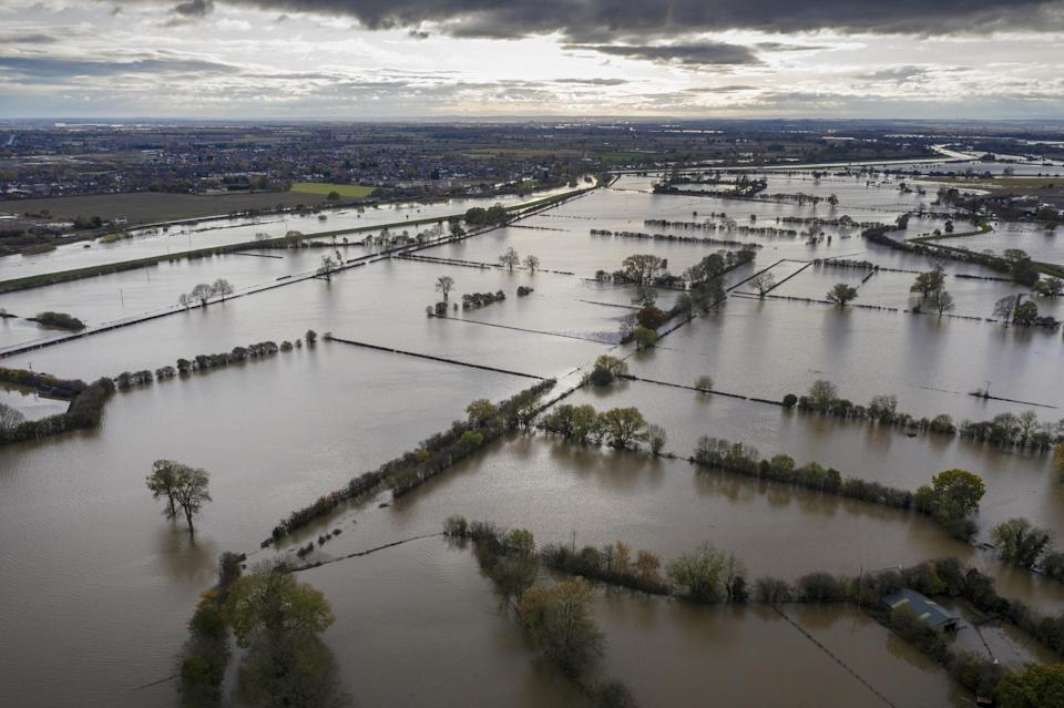 <p>Floodwater coversroads and local houses inFishlake</p>Getty