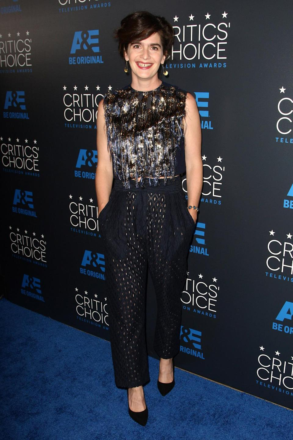 Gaby Hoffman's crop top and trouser combo weren't your typical crop top and trouser combo. The top, longer than most, showed just a hint of skin — the appropriate amount — and was frilly and fun with metallic embellishments. The pants with punctured holes were just as cool and interesting.