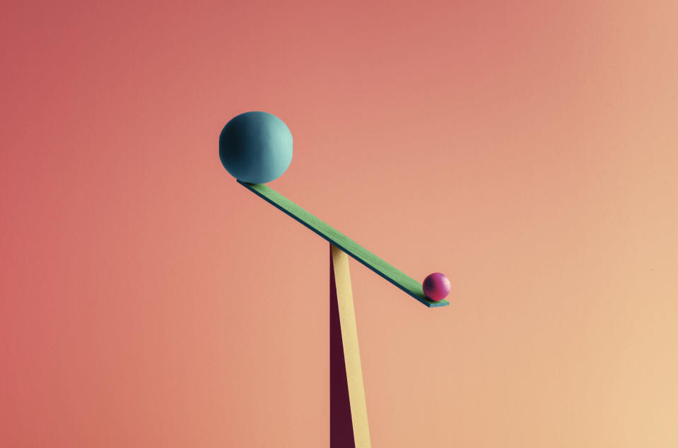 A small ball outweighs a larger one balanced against it