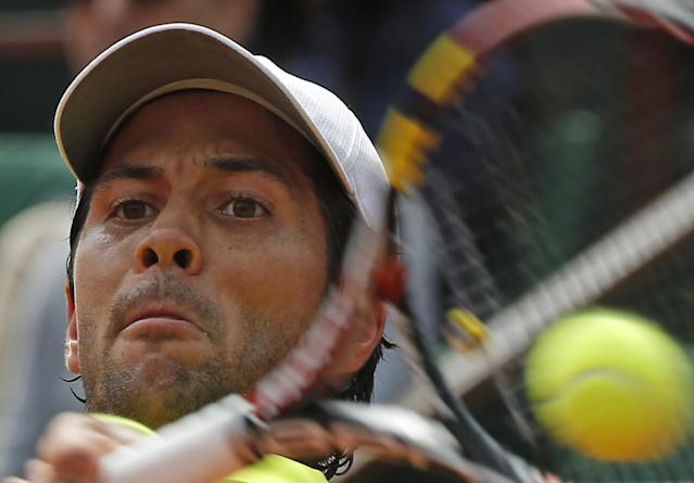 Spain's Fernando Verdasco returns during the third round match of the French Open tennis tournament against France's Richard Gasquet at the Roland Garros stadium, in Paris, France, Sunday, June 1, 2014. Verdasco won in three sets 6-3, 6-2, 6-3. (AP Photo/Michel Euler)