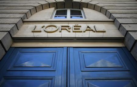 A logo is seen over the entrance of Cosmetics company L'Oreal building in Paris