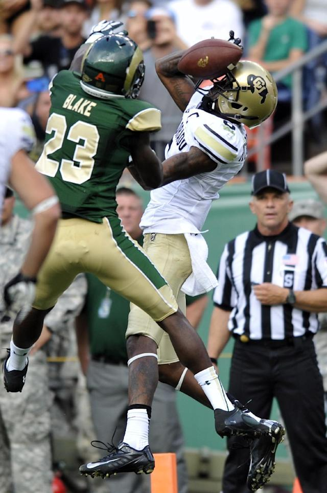 Colorado wide receiver Paul Richardson (6) drops a pass as Colorado State defensive back Bernard Blake (23) defends during the second quarter of an NCAA college football game Sunday, Sept. 1, 2013, in Denver. (AP Photo/Jack Dempsey)
