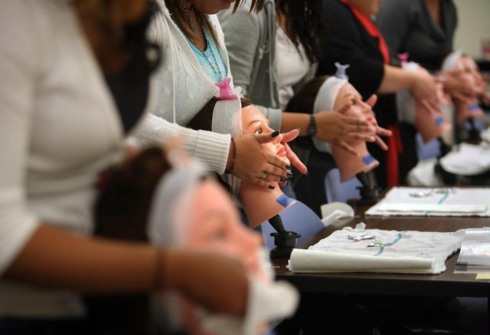 Students practice facial massage in 2011. (PHOTO: Bob Chamberlin/Los Angeles Times via Getty Images)