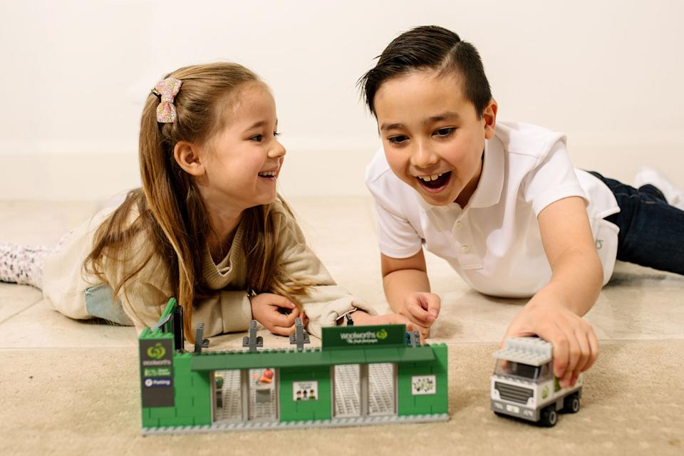 Pictured is two children playing with the new Woolworths collectables.