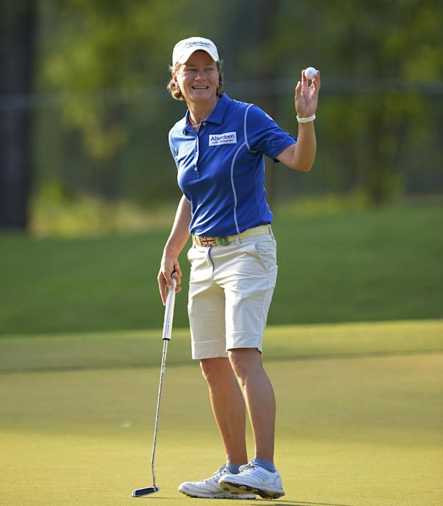 Catriona Matthew, of Scotland, acknowledges the crowds at the 18th hole after putting in the second round of the Airbus LPGA Classic golf tournament at Magnolia Grove on Friday, May 23, 2014, in Mobile, Ala. (AP Photo/G.M. Andrews)