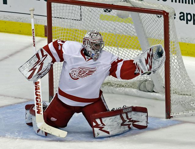 Detroit Red Wings goalie Petr Mrazek (34) catches a shot on goal by the Anaheim Ducks in the first period of an NHL hockey game in Anaheim, Calif., Sunday, Jan. 12, 2014. (AP Photo/Reed Saxon)