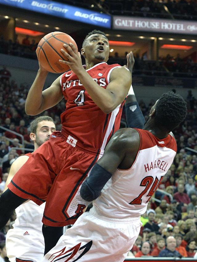 Rutgers' Myles Mack, left, charges into Louisville's Montrezl Harrell while attempting to shoot during the first half of an NCAA college basketball game on Sunday, Feb. 16, 2014, in Louisville, Ky. (AP Photo/Timothy D. Easley)