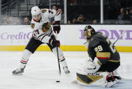 Chicago Blackhawks center Kirby Dach (77) scores on Vegas Golden Knights goaltender Marc-Andre Fleury (29) during the third period of an NHL hockey game Wednesday, Nov. 13, 2019, in Las Vegas. (AP Photo/John Locher)