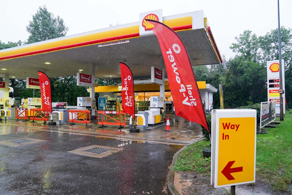 Fuel pumps are out of use at a deserted Shell petrol station forecourt in Warwick. Picture date: Monday September 27, 2021.