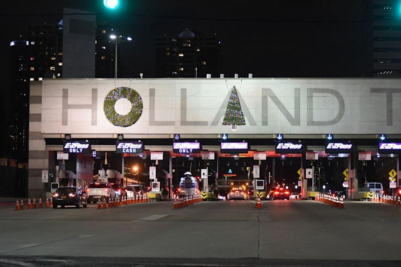 The wreaths at the New York City-bound entrance of the Holland Tunnel in Jersey City were moved.