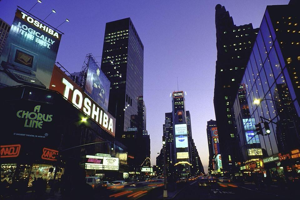 <p>Glowing billboards light up the streets of Times Square from Duffy Square. </p>