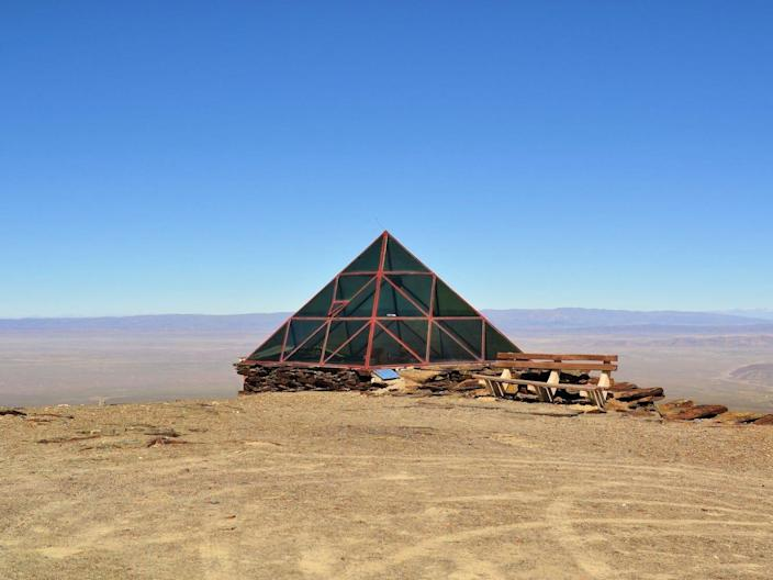 An abandoned glass pyramid weather station on the Chacaltaya mountain.