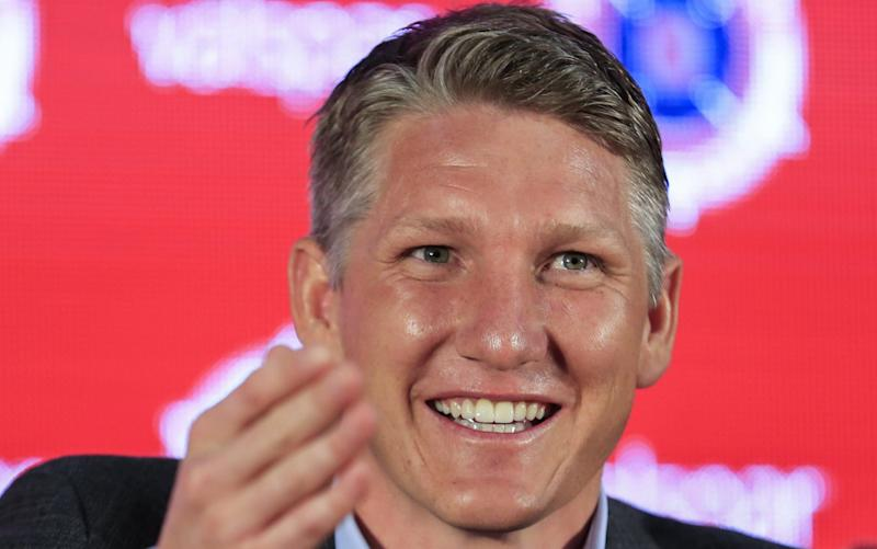 Bastian Schweinsteiger was asked a bizarre question at his first press conference - EPA