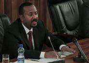 Ethiopia's Prime Minister Abiy Ahmed addresses the legislators on the current situation of the country inside the Parliament Buildings in Addis Ababa