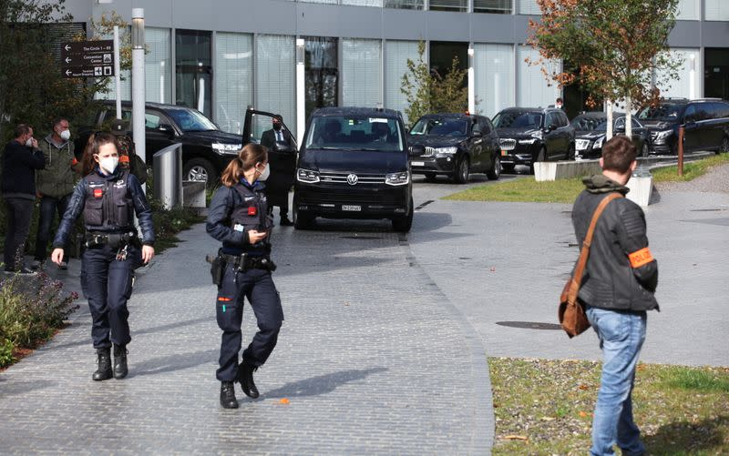 Swiss police officers and a limousine convoy are seen in front of the Hyatt Regency Zurich Airport hotel in Zurich