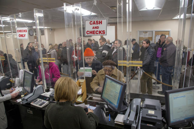 <strong>People line-up at the Town of Hempstead tax receiver's office to pay their real estate taxes before the end of the year, hoping for one last chance to take advantage of a major tax deduction before it is wiped out in the new year. (Howard Schnapp/Newsday via AP)</strong>