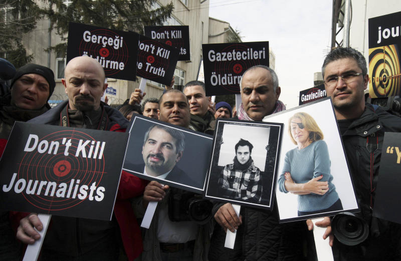 FILE - In this Feb. 24, 2012, file photo,Turkish journalists holding photographs of their colleagues who lost their lives in Syria recently, from left, Anthony Shadid, Remi Ochlik and Marie Colvin, stage a protest outside the Syrian Embassy in Ankara. Behind a veil of secrecy, at least 30 journalists have been kidnapped or have disappeared in Syria – held and threatened with death by extremists or taken captive by gangs seeking ransom. (AP Photo/Burhan Ozbilici, File)