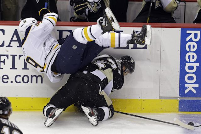 Buffalo Sabres' Steve Ott (9) collides with Pittsburgh Penguins' Chuck Kobasew (12) in the first period of an NHL hockey game in Pittsburgh on Saturday, Oct. 5, 2013. (AP Photo/Gene J. Puskar)