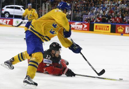 Ice Hockey - 2017 IIHF World Championship - Gold medal game - Canada v Sweden - Cologne, Germany - 21/5/17 - Colton Parayko of Canada in action against Marcus Kruger of Sweden. REUTERS/Grigory Dukor