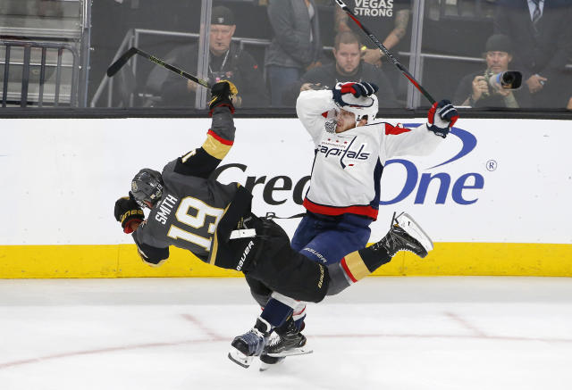 Vegas Golden Knights right wing Reilly Smith, left, collides with Washington Capitals defenseman John Carlson during the first period in Game 2 of the NHL hockey Stanley Cup Finals on Wednesday, May 30, 2018, in Las Vegas. (AP Photo/Ross D. Franklin)