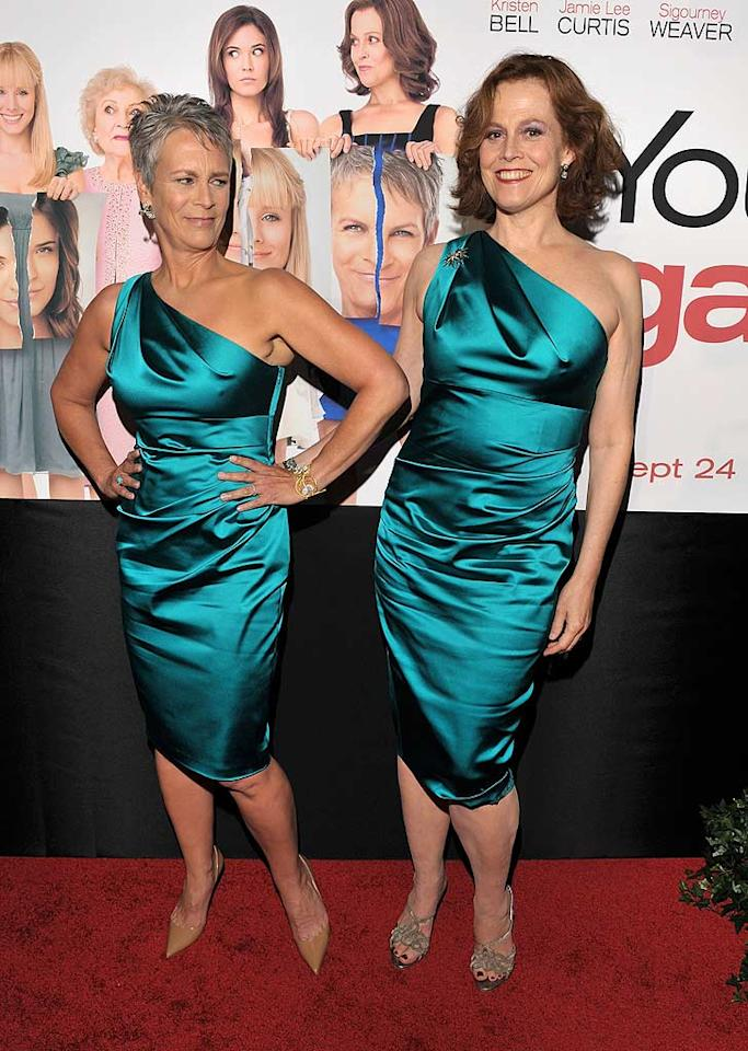 """Jamie Lee Curtis jokingly sneered at her """"You Again"""" co-star Sigourney Weaver for wearing the same one-shoulder dress to the movie's L.A. premiere on Wednesday night. The actresses were mirroring a scene that takes place in the film, where the on-screen rivals show up at a wedding in matching pink frocks. (The horror!) In real life, the actresses adore one another. """"It was such a delight to work with [Curtis],"""" said Weaver. """"She's such an amazing woman. It was really fun to hate her because I really love her."""" Lester Cohen/<a href=""""http://www.gettyimages.com/"""" target=""""new"""">GettyImages.com</a> - September 22, 2010"""
