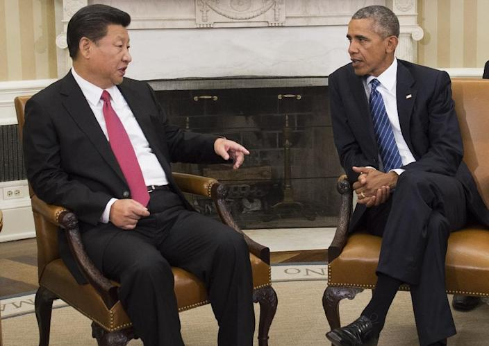 In 2015 Chinese President Xi Jinping (L) promised US president Barack Obama that China would halt the theft of US commercial secrets, which had become a major problem between the two countries (AFP Photo/SAUL LOEB)