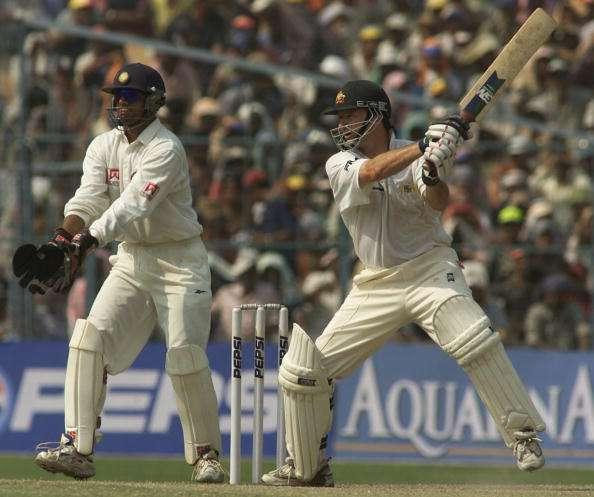 15 Mar 2001: Steve Waugh of Australia hits out with substitute wicketkeeper Rahul Dravid of India looking on, during day five of the 2nd Test between India and Australia played at Eden Gardens, Calcutta, India. X DIGITAL IMAGE Mandatory Credit: HamishBlair/ALLSPORT
