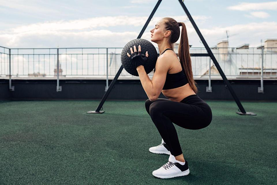 <p>This movement activates the core and also builds good mechanics for healthy knees, which is why McKinney says it's a favorite of hers.</p><p><strong>How to: </strong>Start by standing with legs shoulder width apart, and engage your core. Grab a kettlebell, dumbbell, water jug, etc. and hold it against your chest. Your elbows should be underneath the weight and the weight should be physically touching your chest close to where your sternum meets your collar bone. Keep your feet completely flat on the ground and push your knees out as your lower down. Work to get your hip crease to your knee crease. At the bottom of a squat you should have max knee flexion and max hip flexion. Keep your chest lifted, and engage your glutes on the way back up. </p>