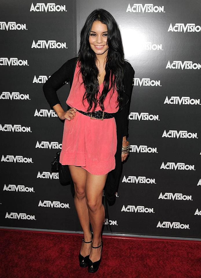 """Vanessa Hudgens was pretty as a picture in her coral, belted mini. Do you think she picked up a few freebies for her beau Zac Efron? Jordan Strauss/<a href=""""http://www.wireimage.com"""" target=""""new"""">WireImage.com</a> - June 14, 2010"""