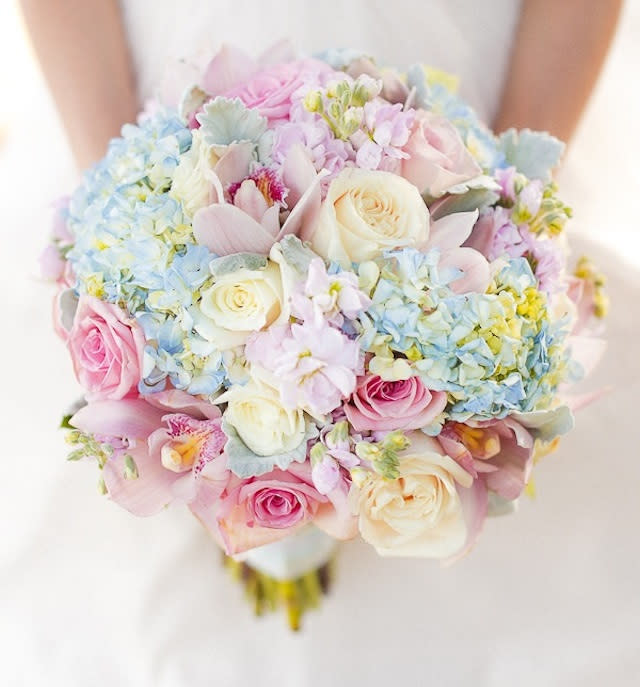 """<div class=""""caption-credit""""> Photo by: MangoRed</div><div class=""""caption-title""""></div>Lots of brides like to carry white flowers for a beach wedding, but we love the subtle pinks and blues in this bouquet! <br> <br> <a rel=""""nofollow"""" href=""""http://lover.ly/explore?q=hydrangea&utm_source=shine04-01-13beach&utm_medium=guest&utm_campaign=shine04-01-13beach"""" target="""""""">See how other brides are using hydrangeas in their decor</a> <br> <br> <br> Photo by: <a rel=""""nofollow"""" href=""""http://r.lover.ly/redir.php/2ohW/QRU04A_aHR0cDovL21hbmdvcmVkLmNvbS8="""" target=""""_blank"""">MangoRed</a> on <a rel=""""nofollow"""" href=""""http://r.lover.ly/redir.php/yOI4/vmhDgM_aHR0cDovL2JyaWRlYW5kYnJlYWtmYXN0LnBoLzIwMTMvMDMvMDcvYS1zdW4ta2lzc2VkLXNlYXNpZGUtYWZmYWlyLw=="""" target=""""_blank"""">Bride and Breakfast</a> via <a rel=""""nofollow"""" href=""""http://lover.ly/image/432861"""" target=""""_blank"""">Lover.ly</a>"""