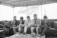<p>Mick Jagger (center) and his bandmates (L-R) Charlie Watts, Keith Richards, Brian Jones, and Bill Wyman sail around New York Harbor on a yacht before they begin the band's fifth American tour, 1969. </p>