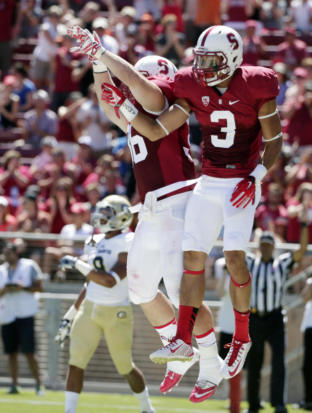 Stanford wide receiver Michael Rector, right, celebrates his touchdown reception with teammate Lee Ward during the first half of an NCAA college football game against UC Davis on Saturday, Aug. 30, 2014, in Stanford, Calif. (AP Photo/Marcio Jose Sanchez)
