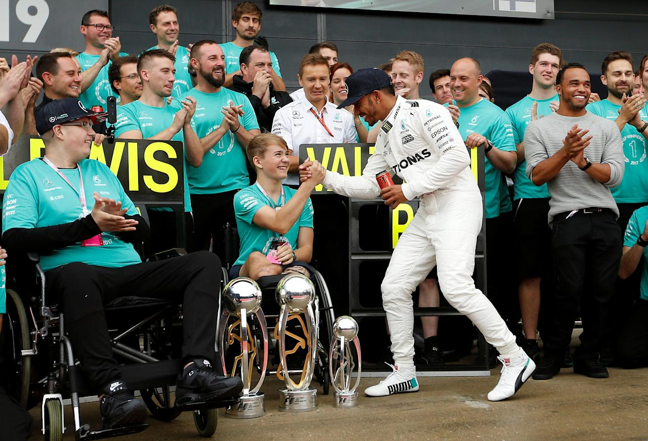 F1 - Formula One - British Grand Prix 2017 - Silverstone, Britain - July 16, 2017   Mercedes' Lewis Hamilton celebrates his win with Billy Monger    REUTERS/Andrew Boyers