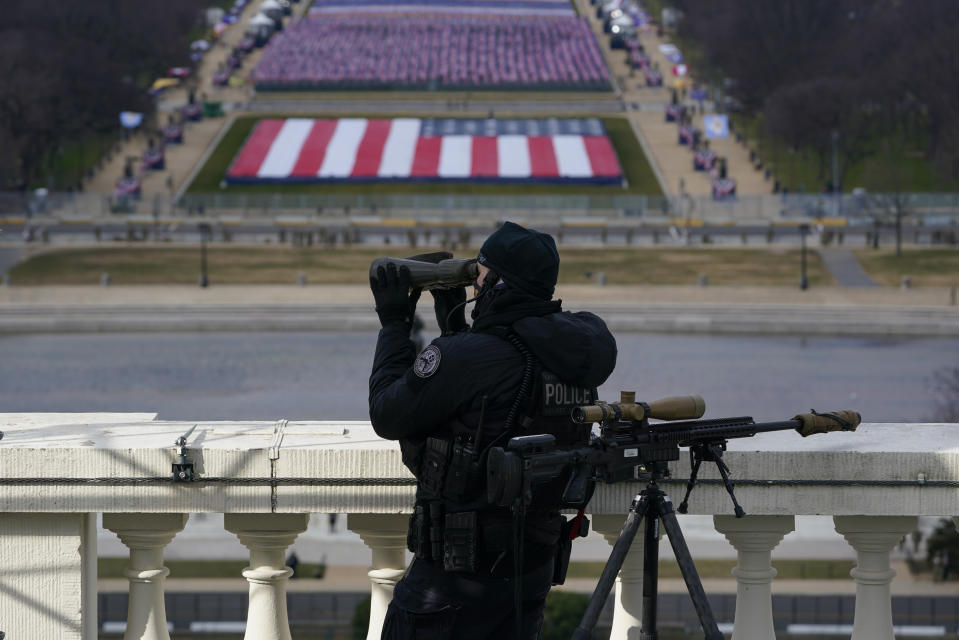 A law enforcement personnel monitors the area during the 59th Presidential Inauguration at the U.S. Capitol in Washington, Wednesday, Jan. 20, 2021. (AP Photo/Susan Walsh, Pool)