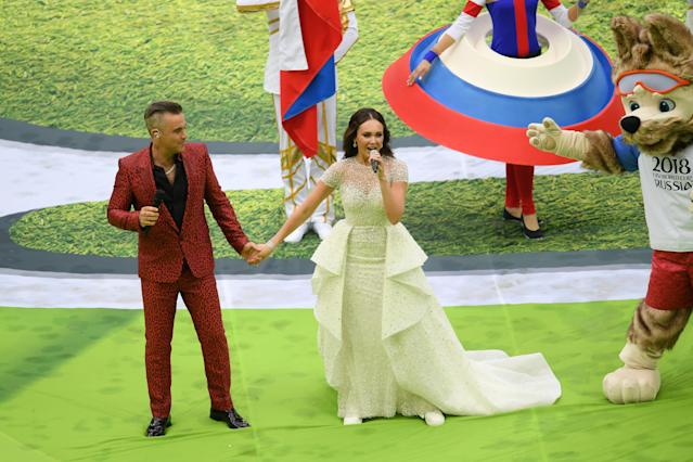 <p>MOSCOW, RUSSIA – JUNE 14: Robbie Williams and Aida Garifullina perform as Mascot Zabivaka the Wolf looks on during the opening ceremony prior to the 2018 FIFA World Cup Russia Group A match between Russia and Saudi Arabia at Luzhniki Stadium on June 14, 2018 in Moscow, Russia. (Photo by Shaun Botterill/Getty Images) </p>
