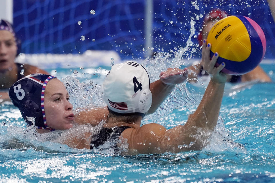 Anastasia Simanovich (8), of the Russian Olympic Committee, pressures United States' Rachel Fattal (4) during a preliminary round women's water polo match at the 2020 Summer Olympics, Friday, July 30, 2021, in Tokyo, Japan. (AP Photo/Mark Humphrey)