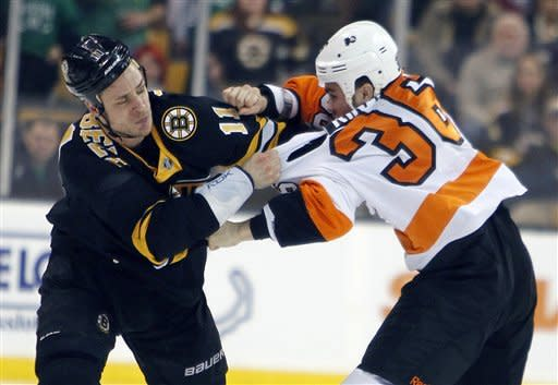 Boston Bruins' Gregory Campbell (11) and Philadelphia Flyers' Zac Rinaldo (36) fight in the first period of an NHL hockey game in Boston, Saturday, March 17, 2012. (AP Photo/Michael Dwyer)