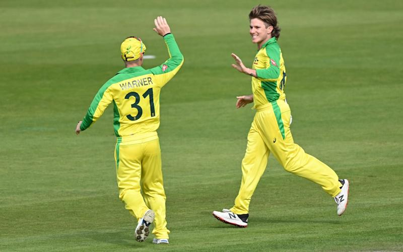 Australia's Adam Zampa (R) celebrates with Australia's David Warner after taking the wicket of England's Eoin Morgan during the one-day international (ODI) cricket match between England and Australia at Old Trafford in Manchester on September 16, 202 - AFP/ SHAUN BOTTERILL