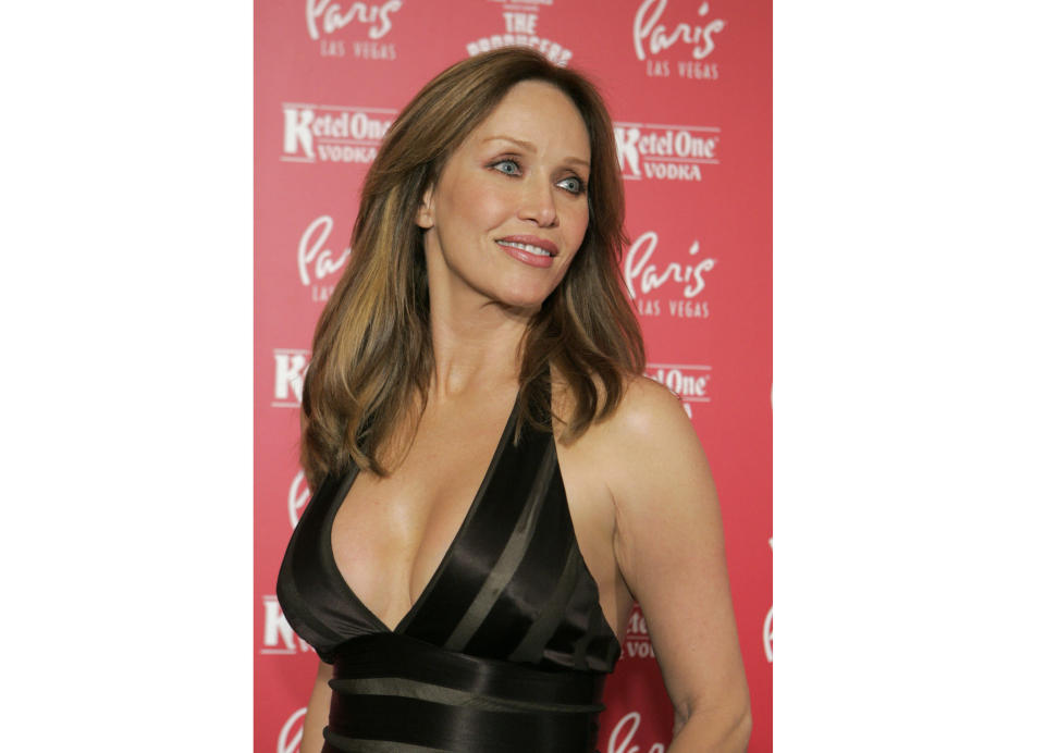 """FILE - Actress Tanya Roberts poses for photos at the grand opening of the musical comedy """"The Producers"""" at the Paris hotel-casino in Las Vegas on Feb. 9, 2007. Roberts, who captivated James Bond in """"A View to a Kill"""" and had roles on """"Charlie's Angels"""" and """"That '70s Show,"""" died Sunday, Jan. 3, 2021. She was 65. Her death was announced by her publicist. No cause of death was given. (AP Photo/Jae C. Hong, File)"""