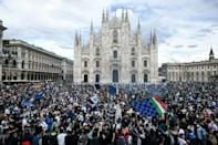 Inter fans celebrate their first Serie A title in 11 years at Piazza Duomo in Milan
