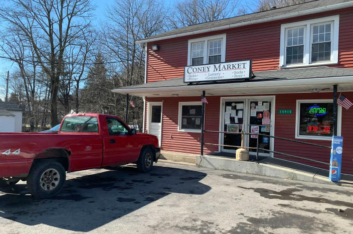 A pickup truck is parked by the Coney Market in Lonaconing, Md. a 1,200-person town in Western Maryland, where a winning, $731.1 million Powerball ticket was sold last week, Thursday, Jan. 21, 2021. (Colin Campbell/The Baltimore Sun via AP)