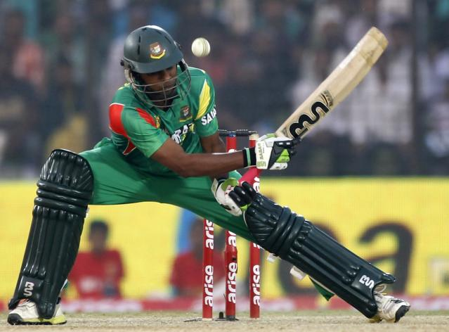 Bangladesh's Sohag Gazi plays a ball against India during their Asia Cup 2014 one-day international (ODI) cricket match in Fatullah February 26, 2014. REUTERS/Andrew Biraj (BANGLADESH - Tags: SPORT CRICKET)