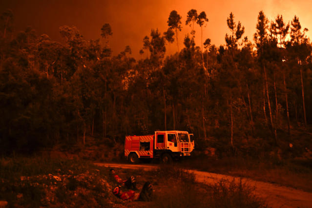 <p>A fire truck is shown during a wildfire at Penela, Coimbra, central Portugal, on June 18, 2017. (Patricia De Melo Moreira/AFP/Getty Images) </p>