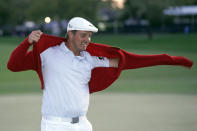 Bryson DeChambeau puts on the championship red sweater after winning the Arnold Palmer Invitational golf tournament Sunday, March 7, 2021, in Orlando, Fla. (AP Photo/John Raoux)