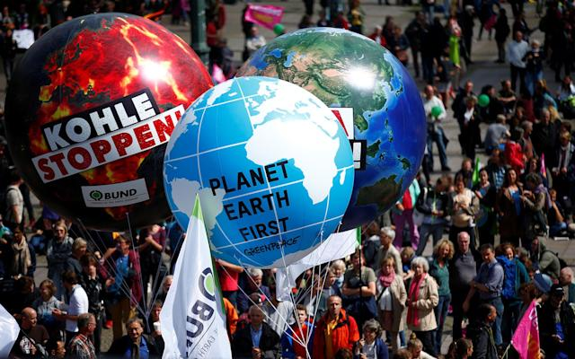 <p>People with giant balloons take part in protests ahead of the upcoming G20 summit in Hamburg, Germany July 2, 2017. (Hannibal Hanschke/Reuters) </p>