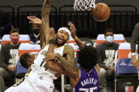 New Orleans Pelicans forward Brandon Ingram, left, is fouled by Sacramento Kings forward Marvin Bagley III during the first quarter of an NBA basketball game in Sacramento, Calif., Sunday, Jan. 17, 2021. (AP Photo/Rich Pedroncelli)